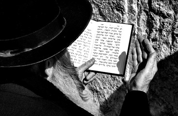 High Angle View Of Man Reading Quran