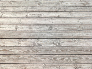 Dark dilapidated cracked boards. Wood old table. Rustic timber texture. Weathered oak planks. Interior decoration. Natural wooden background, pattern.