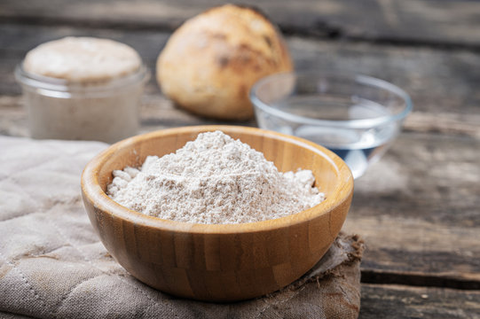 Closeup view of organic whole spelt flour in wooden cup
