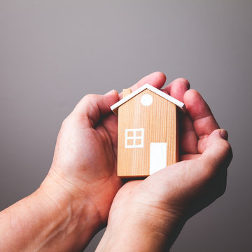 Hands Holding House/ 1x1