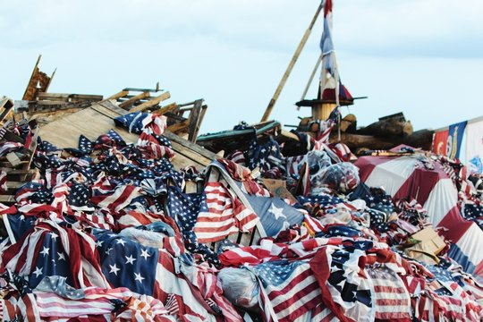 Heap Of American Flags On Wooden Pallets During Memorial Event