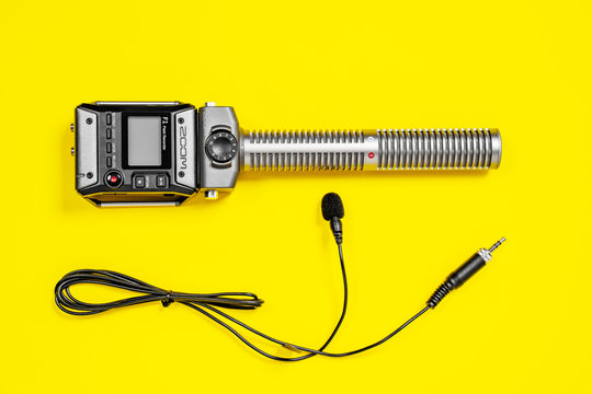 April 11, 2020, Rostov-on-Don, Russia: Handheld zoom audio recorder with buttons and screen above, shotgun microphone at bottom line, on bright yellow background.