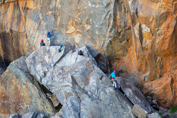Rock climbers on a cliff at a quarry in Western Australia