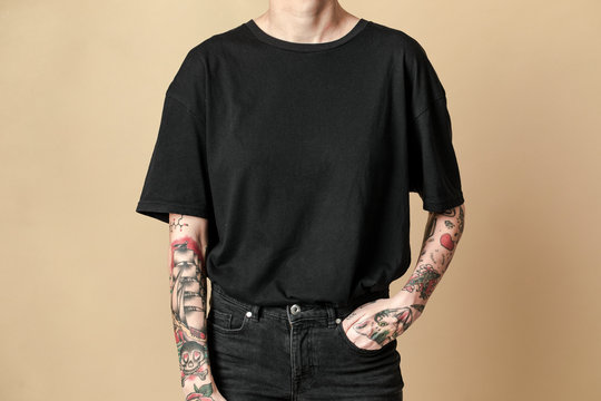Cool tattooed woman in black clothes
