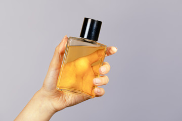 Woman with a cologne bottle