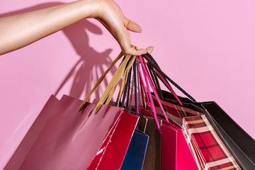 Shopaholic woman with shopping bags