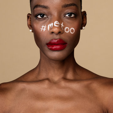 Hashtag metoo on an African American woman's face