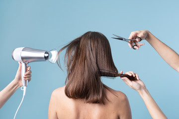 Woman getting a haircut and blow drying her hair