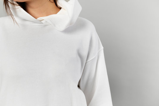 Woman in a white hoodie