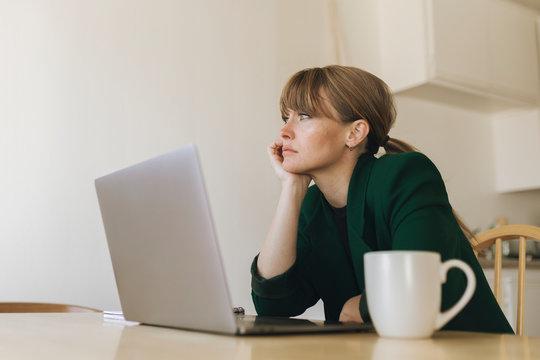 Bored woman working from home during coronavirus quarantine