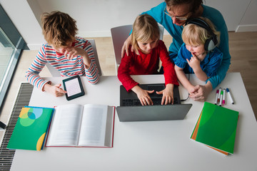 family on distant learning at home, online education for kids