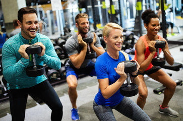 Group of friends smiling and enjoy sport in gym