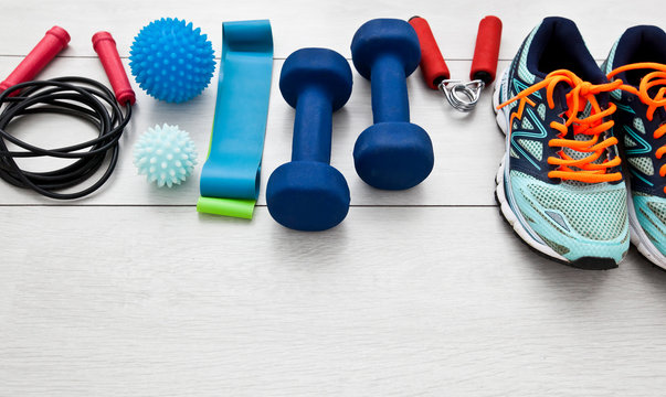 The fitness tools and  a equipment on the wooden floor. Concept of home physical training and staying at home