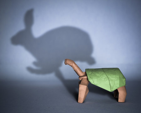 Concept of hidden potential. A paper figure of a turtle casting a shadow of a rabbit. 3D illustration