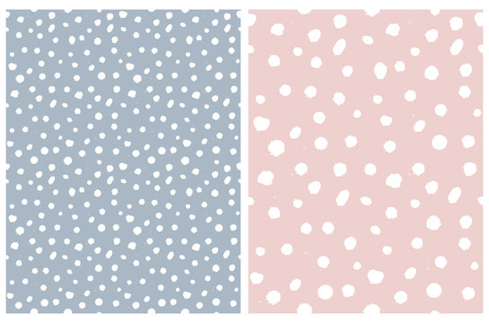 Simple Rough Dotted Seamless Vector Patterns. White Hand Drawn Brush Dots Isolated on a Pale Blue and Pastel Pink Background. Infantile Style Geometric Repeatable Print. Irregular Polka Dots Backdrop.