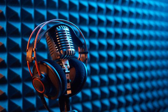 Studio condenser microphone with professional headphones acoustic panel
