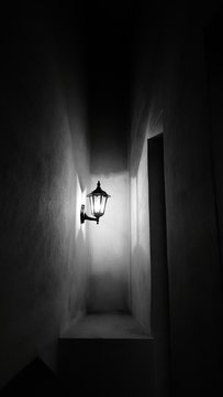 Illuminated Sconce In Corridor