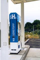 hydrogen logo on gas stations fuel dispenser. h2 combustion engine for emission free ecofriendly transport. germany