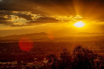 Foto auf Gartenposter Violett rot Scenic View Of Sunset Over Landscape