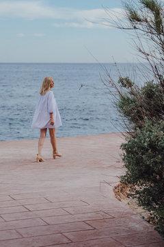 Woman walking alone on a beach