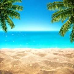 Fototapete - Summer sandy beach with blured tropical sea view with empty space for product display advertistment
