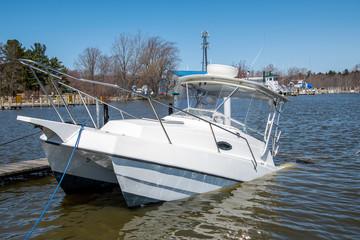 white catamaran boat sinking in boat slip