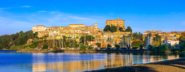 travel in Italy - picturesque tranquil Capodimonte village and beuautiful lake lago Bolsena, Lazio region