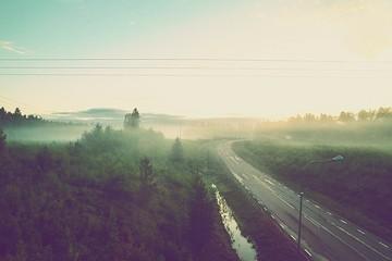 Foto auf Gartenposter Aubergine lila High Angle View Of Empty Road Amidst Landscape