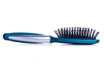 Blue hair brush on white background isolation