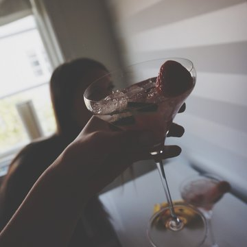 Cropped Image Woman Holding Cocktail At Home