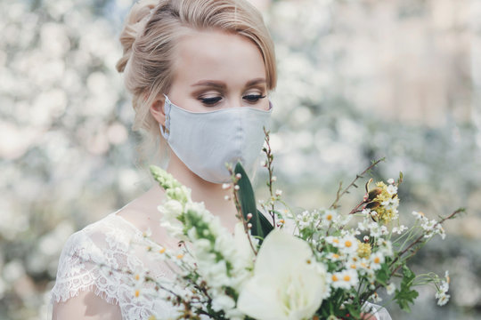 charming bride in protective mask. portrait of a blonde in a dress during the pandemic