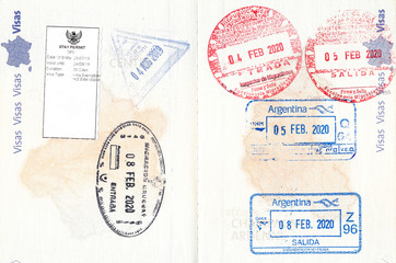 Photo sur Aluminium Amérique du Sud Immigration stamps of Indonesia, Uruguay, Paraguay and Argentina in a French passport. No personal data
