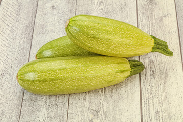 Fotobehang - Young tasty zucchini over board