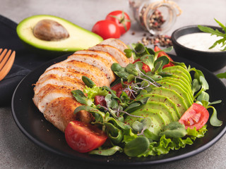 Fototapete - roasted sliced chicken fillet with avocado, tomato, sunflower sprouts healthy food
