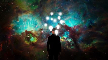Wall Mural - Big Ideas. Man in black suit before vivid nebula