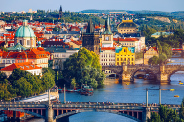 Poster Prague Scenic view of the Old Town pier architecture and Charles Bridge over Vltava river in Prague, Czech Republic. Prague iconic Charles Bridge (Karluv Most) and Old Town Bridge Tower at sunset, Czechia.
