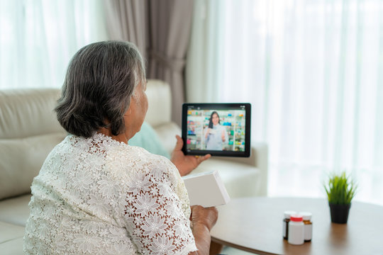 Asian senior woman using video conference, make online consultation with pharmacy consulting about illness and medication via video call. Telehealth, Telemedicine and online hospital.