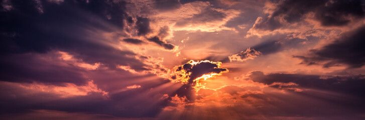 Spoed Fotobehang Bordeaux panorama of sun breaking through clouds at sunset amazing sky background