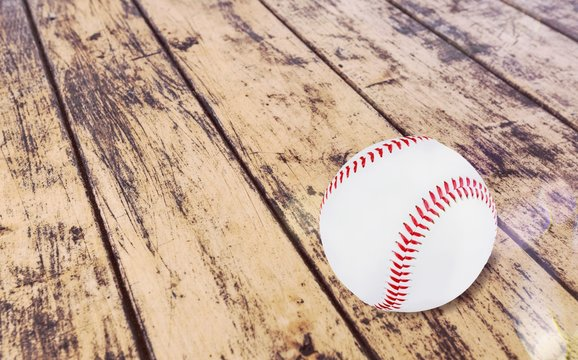 Baseball ball with seams on the wooden desk