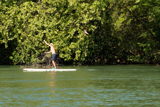 Paddle Boarder on Lake Austin Texas