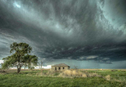 Abandoned houses on the Great Plains with Impending Summertime Severe Weather