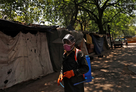 Dev Dutt Sharma, a sanitation worker, looks on as he waits while on his way to disinfect a street in a colony, during an extended nationwide lockdown to slow the spread of the coronavirus disease (COVID-19), in New Delhi