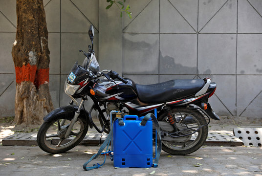 A disinfectant dispenser tank used by Dev Dutt Sharma, a sanitation worker, is pictured next to his bike, on a street, during an extended nationwide lockdown to slow the spread of the coronavirus disease (COVID-19), in New Delhi