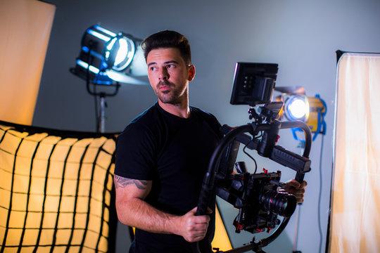 Attractive man with movie camera