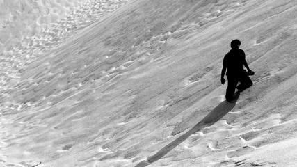Tilt Image Of Man Amidst Sand On Desert
