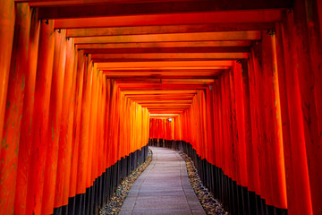Red wooden torii Gate at Fushimi Inari Shrine in Kyoto, Japan. One of the popular site in Kyoto.