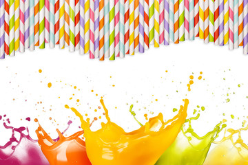 Wall Mural - multicolor juice splashes and drinking straws on white background