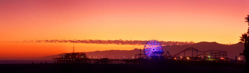 Panoramic View Of Ferris Wheel By Santa Monica Pier Against Sky During Sunset