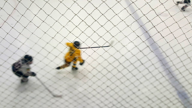 High Angle View Of Ice Hockey Player Skating On Rink