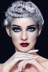 Portrait of beautiful woman with fancy makeup and silver hair